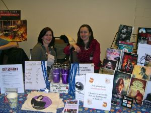 Lisa Bouchard and Jen Pelland at the Broad Universe table in the Huckster's Room